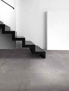 Glad ongepolijst ijzersterke beton gelijkende vloer Interfloor Dynamic Cemento Collectie